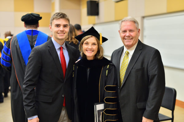 President Cottrell, her son Andy, and her husband Alan